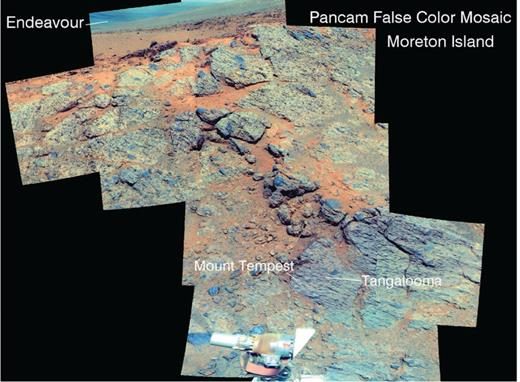 Pancam false color image mosaic of the Moreton Island outcrop on Murray Ridge, with the Tangalooma and Mount Tempest in situ targets shown. These highly fractured rocks are impact breccias with embedded rock clasts. For reference the outcrop with the two in situ targets is approximately 0.25 m wide. Pancam images were acquired on sols 3494–3496, with bands centered at 0.753, 0.535, and 0.432 μm shown as RGB colors. This band assignment is the same as other Pancam false color data shown in subsequent figures. Mosaic available as http://photojournal.jpl.nasa.gov/catalog/PIA17753.