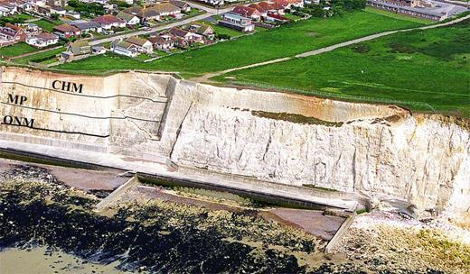 Low-angle aerial photograph of the zig-zag steps cut into the cliff of Campanian chalk at Peacehaven, Sussex. The section between the Old Norse Marl (ONM) and the Castle Hill Marl (CHM) was sampled. Stratigraphy based on Mortimore (1986). MP is the Meeching Marl Pair.