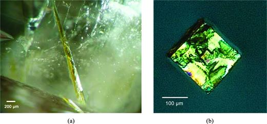 (a): Perettiite-(Y) inclusion (light yellow needle ca. 2 mm long and 0.2 mm thick) in phenakite. (b): A fragment of the needle (ca. 0.2 mm in all dimensions) was liberated by crushing the phenakite host crystal. The picture was taken under crossed polarizers in oil and the crystal is oriented with the needle axis parallel to the light beam.