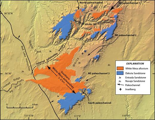 Topical geologic map of White Mesa area showing tributary paleochannels entering southern White Mesa paleovalley. Northeast (NE) paleochannel 3 and south paleochannel contain exotic gravel clasts, whereas others have clasts composed primarily of upper Cretaceous sandstone. Basal contact of Entrada Sandstone is not mapped. Contact of alluvium with bedrock is dashed where covered.