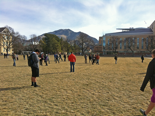 """Nearly 100 physical geology students, working individually or in groups, play through """"Grand Canyon Expedition: Geologic Structures"""" during class time on their campus quad."""