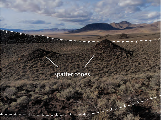 Two spatter cones on the floor of a larger crater (rim shown with dashed line). The largest spatter cone is ∼5 m high. Location: 38°31′43″N, 115°57′06″W.