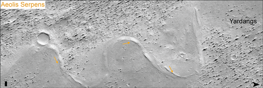 Portion of the paleochannel Aeolis Serpens showing twin lateral ridges (orange arrows). See Figure 1 for location. Bar in lower left is 100 m wide, chevron in lower right points north, and illumination is from the northwest. Image is from a mosaic of CTX images.