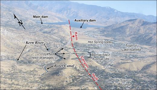 Oblique aerial photograph looking northeast across the southern Hot Spring Valley. Photograph shows several uplifted relict drainages (wind gaps) located on the upthrown side (west side) of the Kern Canyon fault near the Bernie-Silicz Avenue paleoseismic site.
