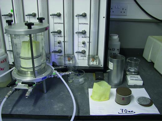 Flexible wall permeameter main vessel and control panel showing fully assembled equipment (left) and sample, porous stones and latex membrane (right).