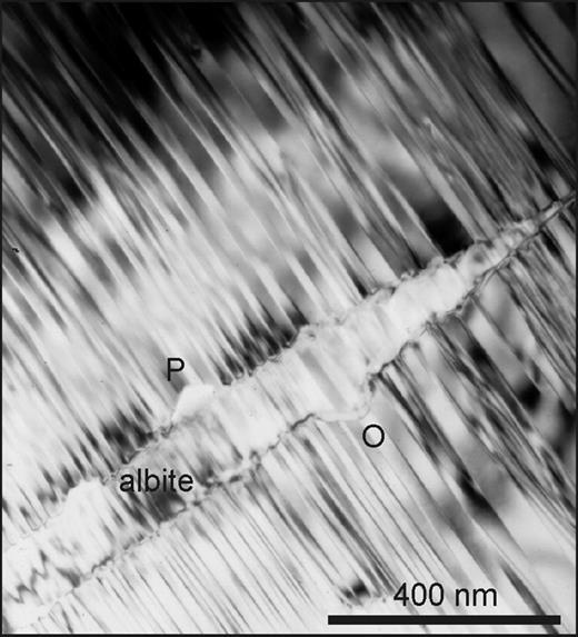 Perth. TEM image of the wedge-shaped end of a cryptoperthitic albite lamella in Albite-twinned microcline. Albite twins in the albite have the same thickness as abutting twins in microcline, and the interface has zig-zag corrugations. This suggests that exsolution occurred after twinned microcline had formed. Larger, steeper zig-zag outgrowths (O) grew subsequently by replacement and have the {110} pericline habit. Pores (P) have the same habit.