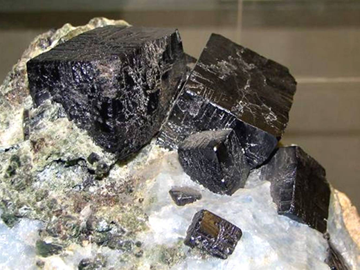 Perovskite crystals from the type locality, Akhmatovskaya Kop, in the Kusinskii Massif, Urals (Russia). Photo credit: A. A. Evseev, Fersman Museum, Moscow.