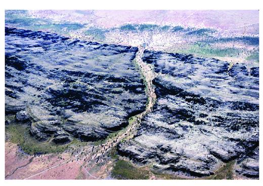 —Menyous Gap in the Pillara Range from the air, looking north. This gap, 2 km long, is interpreted to be a large subglacial channel, exhumed through the removal of Lower Permian deposits by Cenozoic erosion.