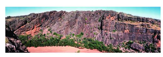 —Panoramic view of the Classic Face at Windjana Gorge, showing flat-bedded back-reef and reef-flat limestones on the right, passing into massive reef-margin in the center and steeply dipping marginal-slope deposits on the left.